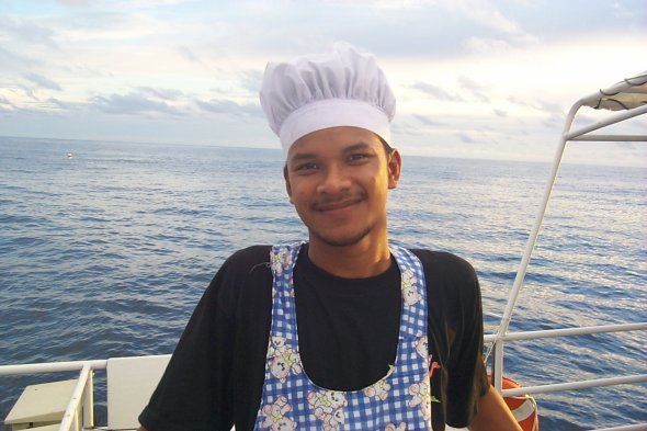 [The boat's Thai chef (49kb)]